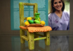 Miniature green chair with fruit on it